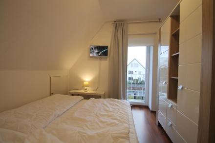 Schlafzimmer 2 im Obergeschoss mit TV