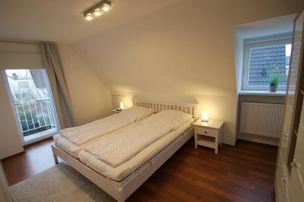 Schlafzimmer 3 im Obergeschoss mit TV