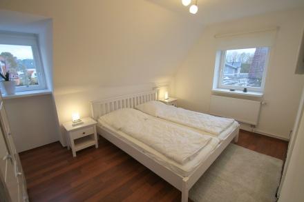 Schlafzimmer 4 im Obergeschoss mit TV